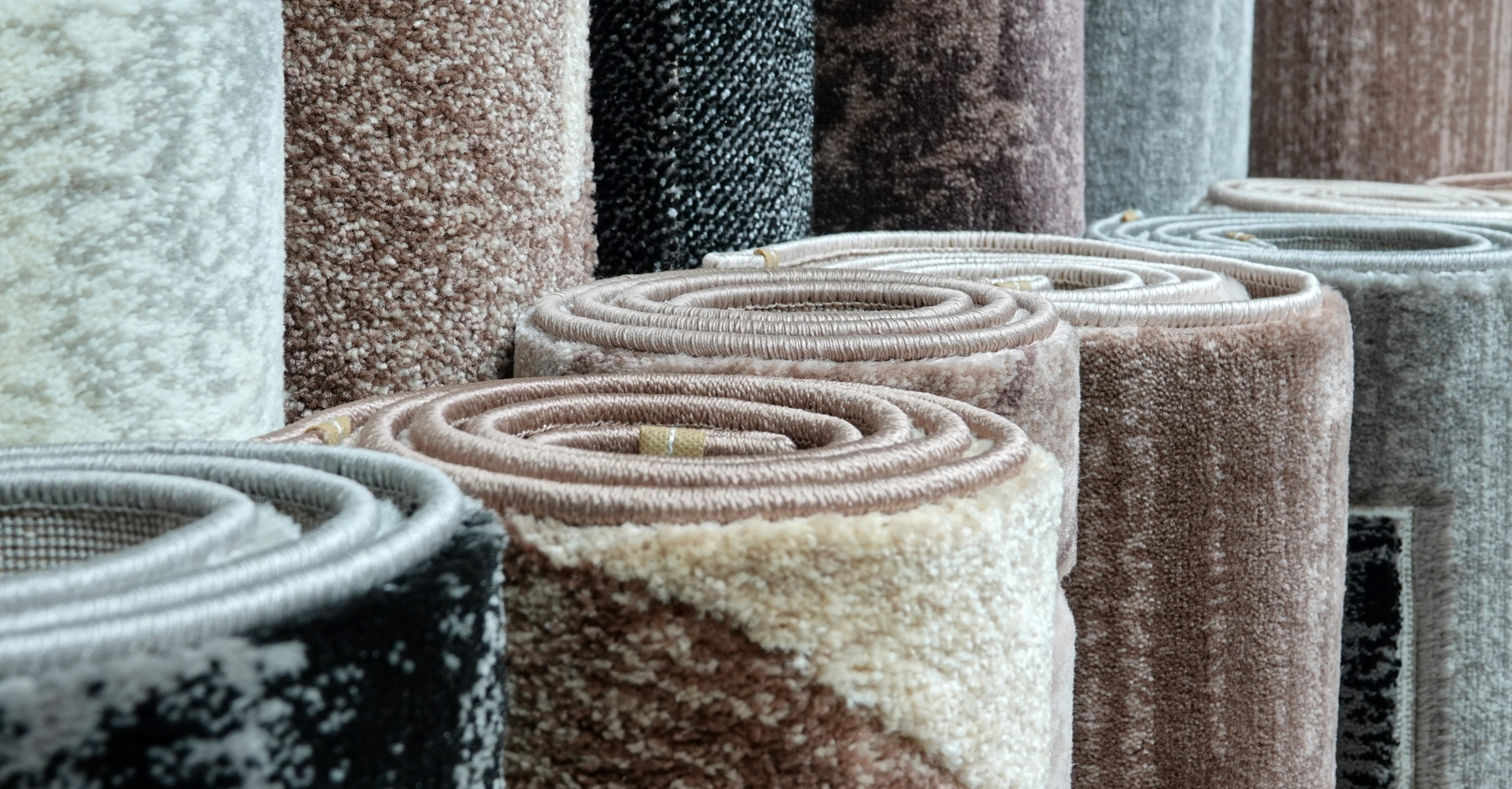 twelve rolled up rugs in various colour, stood upright, K & M Carpets & Interiors, Shaftesbury Mews, Bath, Whiteway, Twerton, Bear Flat, The Oval, Southdown